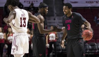SMU's Sterling Brown (3) celebrates  with Ben Emelogu II (21) as Temple's Quinton Rose (13) walks off the court during the second half of an NCAA college basketball game, Thursday, Feb. 9, 2017, in Philadelphia. (AP Photo/Chris Szagola)