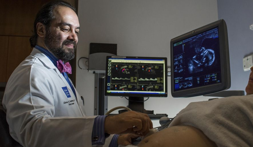 Dr. Alireza Shamshirsaz, an Iranian-born professor of obstetrics and gynecology at Baylor College of Medicine, is part of the Texas Children's Fetal Center,'one of only a handful of centers in the world capable of performing complicated open fetal surgeries. The Houston surgeon has cancelled a trip to Iran to perform life-saving surgeries because of uncertainty over the future of President Donald Trump's refugee and immigration travel ban. (Allen S. Kramer/Texas Children's Hospital via AP)