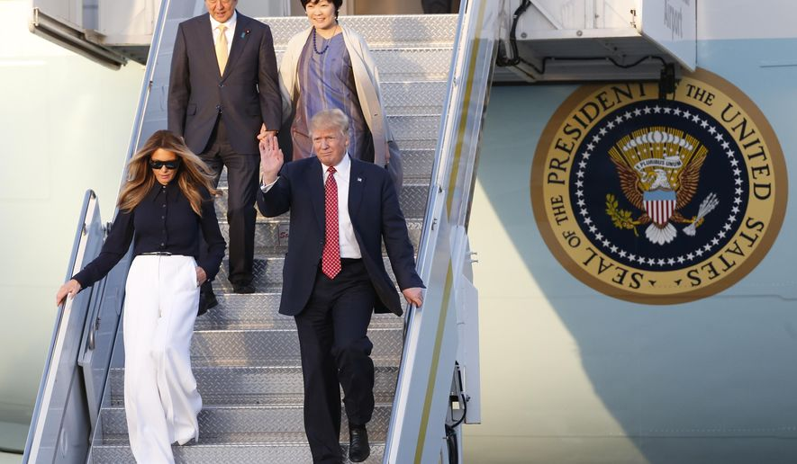 President Donald Trump and first lady Melania Trump Japanese Prime Minister Shinzo Abe and his wife Akie Abe step off of Air Force One as they arrive in West Palm Beach, Fla., Friday, Feb. 10, 2017. (AP Photo/Wilfredo Lee)