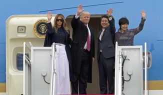 President Donald Trump and Japanese Prime Minister Shinzo Abe, accompanied by their wives, first lady Melania Trump and Akie Abe, wave before boarding Air Force One at Andrews Air Force Base Md., Friday, Feb. 10, 2017. Trump is hosting Abe at his estate Mar-a-Lago in Palm Beach, Fla., for the weekend. ( AP Photo/Jose Luis Magana)