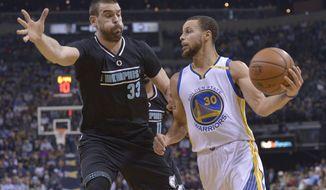 Golden State Warriors guard Stephen Curry (30) drives against Memphis Grizzlies center Marc Gasol (33) during the first half of an NBA basketball game Friday, Feb. 10, 2017, in Memphis, Tenn. (AP Photo/Brandon Dill)