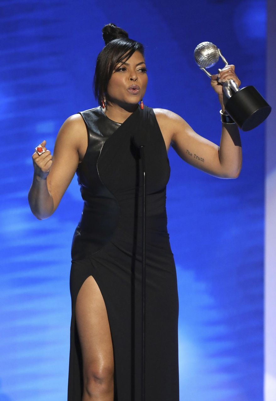 """Taraji P. Henson accepts the award for outstanding actress in a drama series for """"Empire"""" at the 48th annual NAACP Image Awards at the Pasadena Civic Auditorium on Saturday, Feb. 11, 2017, in Pasadena, Calif. (Photo by Matt Sayles/Invision/AP)"""