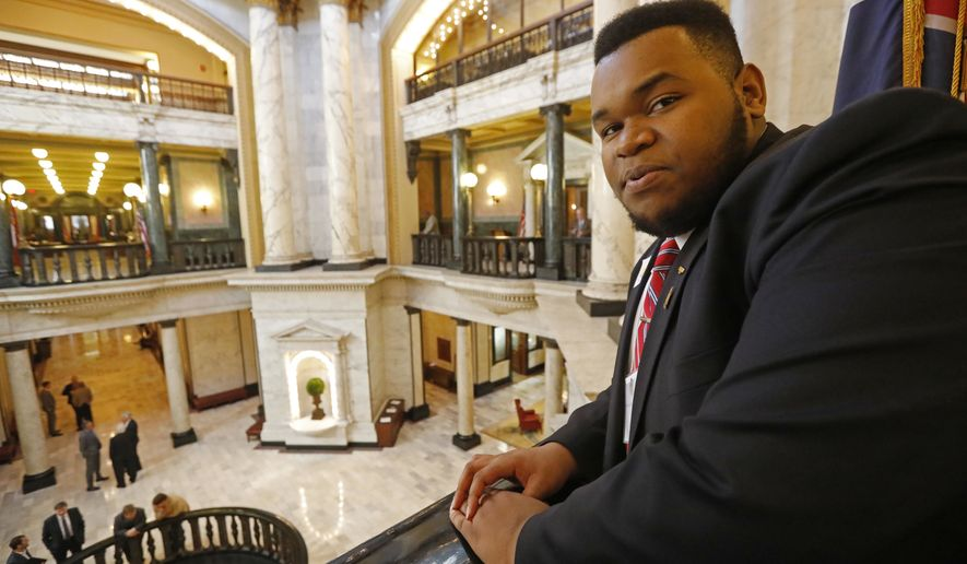 In this Feb. 9, 2017 photo, taken in the rotunda at the State Capitol in Jackson, Miss., House page, Kyle Pernell, 17, of Moorhead, Miss., enjoys the view of a venue he has been learning about this week. Pernell, who was ordained as a Baptist pastor at age 17, had the unique opportunity to put his skills to work at the Mississippi Capitol by offering the opening prayer one this week at the state House, where he spent the week running errands as a page. (AP Photo/Rogelio V. Solis)