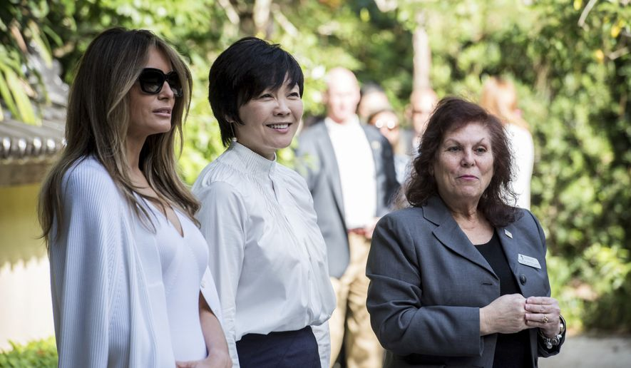 First lady Melania Trump, left, and Akie Abe, wife of Japanese Prime Minister Shinzo Abe, center, tour Morikami Museum and Japanese Gardens with park administrator Bonnie White Lemay in Delray Beach, Fla., on Saturday, Feb. 11, 2017.   (Michael Ares/Palm Beach Post via AP)