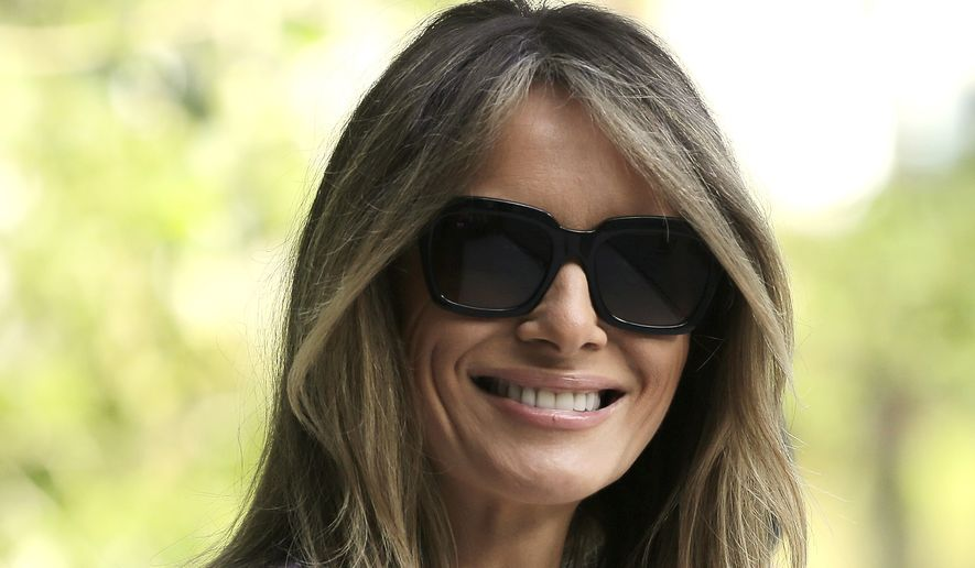 First lady Melania Trump smiles during a tour of the Morikami Museum and Japanese Gardens in Delray Beach, Fla., on Saturday, Feb. 11, 2017. (AP Photo/Terry Renna)