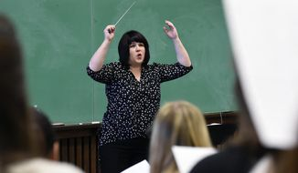 ADVANCE FOR SATURDAY, FEB. 11, 2017 - In this Tuesday, Jan. 31, 2017 photo, conductor, teacher and composer Dr. Andrea Ramsey, conducts her University Choir class at the Macky Auditorium on the University of Colorado Boulder, Colo. campus. (Jeremy Papasso /Daily Camera via AP)