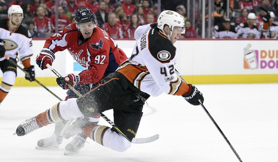 Anaheim Ducks defenseman Josh Manson (42) is tripped by Washington Capitals center Evgeny Kuznetsov (92), of Russia, during the first period of an NHL hockey game, Saturday, Feb. 11, 2017, in Washington. (AP Photo/Nick Wass)