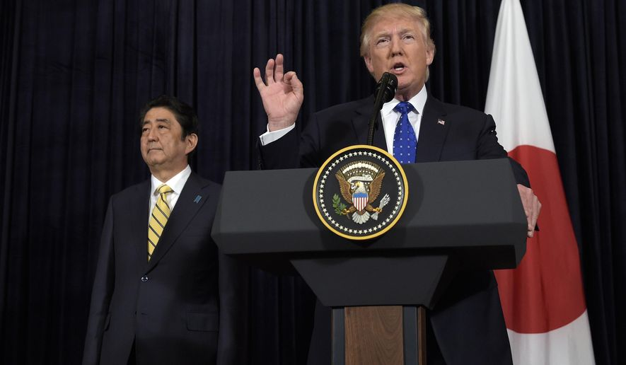 President Donald Trump speaks as Japanese Prime Minister Shinzo Abe listens as they both made statements about North Korea at Mar-a-Lago in Palm Beach, Fla., Saturday, Feb. 11, 2017. (AP Photo/Susan Walsh)