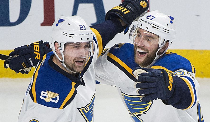 St. Louis Blues center Patrik Berglund (21) celebrates with defenseman Alex Pietrangelo (27) after scoring against the Montreal Canadiens during the second period of an NHL hockey game Saturday, Feb. 11, 2017, in Montreal. (Graham Hughes/The Canadian Press via AP)