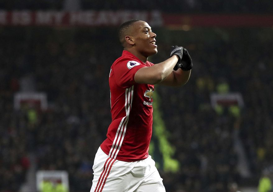Manchester United's Anthony Martial celebrates scoring his team's second goal of the game, during the English  Premier League soccer match between Manchester United and Watford, at Old Trafford, in Manchester, England, Saturday, Feb. 11, 2017. (Nick Potts/PA via AP)