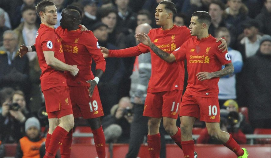 Liverpool's Sadio Mane, 2nd left, celebrates scoring his side's first goal during the English Premier League soccer match between Liverpool and Tottenham Hotspur at Anfield, Liverpool, England, Saturday, Feb. 11, 2017. (AP Photo/Rui Vieira)
