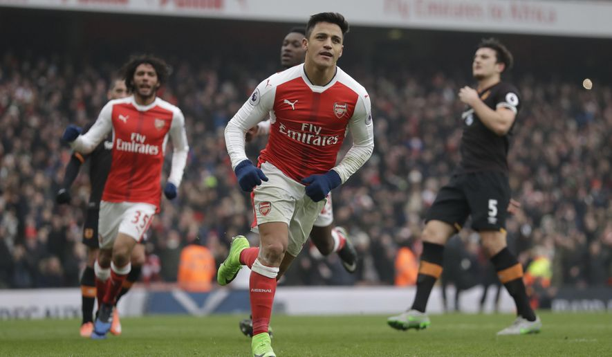 Arsenal's Alexis Sanchez celebrates scoring his side's second goal from a penalty during the English Premier League soccer match between Arsenal and Hull City at the Emirates Stadium in London, Saturday, Feb. 11, 2017. (AP Photo/Matt Dunham)
