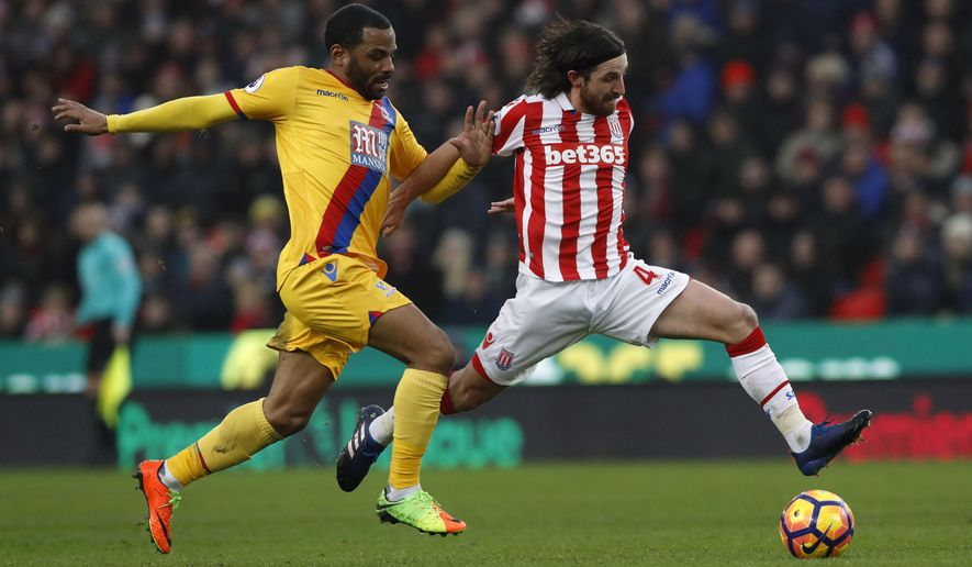 Crystal Palace's Jason Puncheon, left and Stoke City's Joe Allen vie for the ball, during the English  Premier League soccer match between Stoke City and Crystal Palace, at the bet365 Stadium, in Stoke, England, Saturday, Feb. 11, 2017. (Martin Rickett/PA via AP)