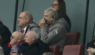 Arsenal's French manager Arsene Wenger watches from the stands at the start of the second half during the English Premier League soccer match between Arsenal and Hull City at the Emirates Stadium in London, Saturday, Feb. 11, 2017. (AP Photo/Matt Dunham)