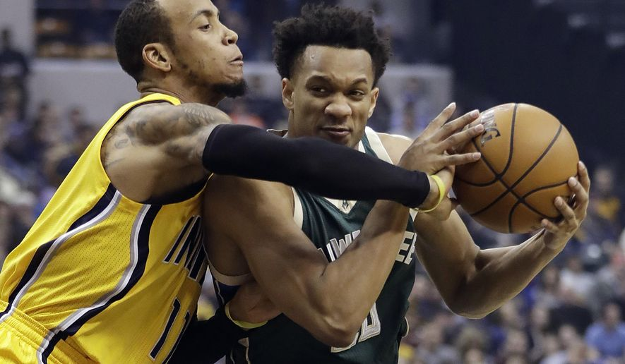 Milwaukee Bucks' Rashad Vaughn, right, is defended by Indiana Pacers' Monta Ellis during the first half of an NBA basketball game Saturday, Feb. 11, 2017, in Indianapolis. (AP Photo/Darron Cummings)