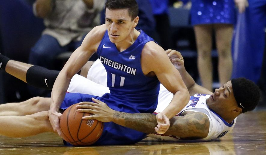 Creighton guard Tyler Clement, left, and DePaul guard Devin Gage battle for a loose ball during the first half of an NCAA college basketball game Saturday, Feb. 11, 2017, in Rosemont, Ill. (AP Photo/Nam Y. Huh)