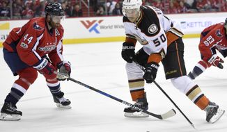 Anaheim Ducks center Antoine Vermette (50) skates with the puck against Washington Capitals defenseman Brooks Orpik (44) during the second period of an NHL hockey game, Saturday, Feb. 11, 2017, in Washington. (AP Photo/Nick Wass)