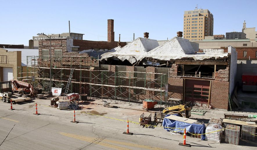 In this Friday, Feb. 3, 2017 photo, renovations continue on the former Emeis building located at 218 Iowa Street in downtown Davenport, Iowa. Concerned last year that downtown Davenport would lose one of its historic buildings, Davenport Fire Capt. Sean Terrell went out on a whim to save it. (Kevin E. Schmidt/Quad City Times via AP)