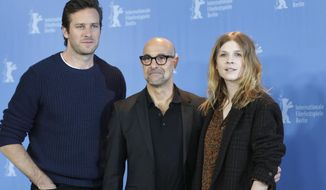 From left, actor Armie Hammer, director Stanley Tucci and actress Clemence Poesy pose for the photographers during a photo call for the film 'Final Portrait' at the 2017 Berlinale Film Festival in Berlin, Germany, Saturday, Feb. 11, 2017. (AP Photo/Michael Sohn)