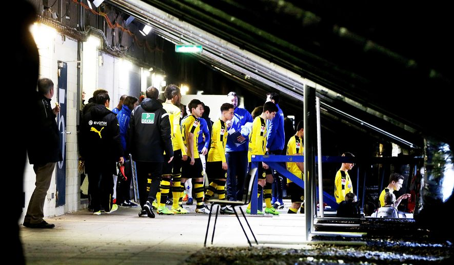 Borussia players prepare to enter the pitch in the catacombs under the main tribune of the old stadium prior to a German first division Bundesliga soccer match between SV Darmstadt 98 and Borussia Dortmund in Darmstadt, Germany, Saturday, Feb. 11, 2017.(AP Photo/Michael Probst)
