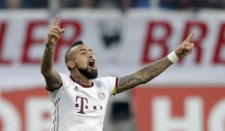 Bayern's Arturo Vidal celebrates after scoring his side's opening goal during the German Bundesliga soccer match between FC Ingolstadt and FC Bayern Munich in Ingolstadt, Germany, Saturday, Feb. 11, 2017. (AP Photo/Matthias Schrader)