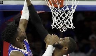 Philadelphia 76ers' Nerlens Noel, left, dunks the ball against Miami Heat's Willie Reed during the first half of an NBA basketball game, Saturday, Feb. 11, 2017, in Philadelphia. (AP Photo/Matt Slocum)
