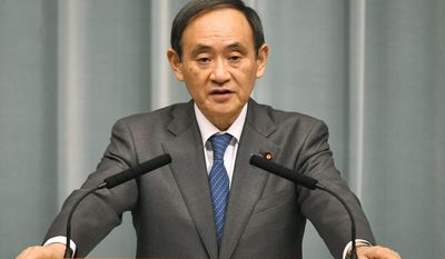 Japan's Chief Cabinet Secretary Yoshihide Suga speaks on a missile launch by North Korea at the prime minister's official residence in Tokyo Sunday, Feb. 12, 2017. North Korea reportedly fired a ballistic missile early Sunday in what would be its first such test of the year and an implicit challenge to President Donald Trump's new administration. The missile is believed to have splashed down into the sea between the Korean Peninsula and Japan. Suga told reporters the missile did not hit Japanese territorial seas. (Muneyoshi Someya/Kyodo News via AP)