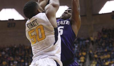 West Virginia forward Sagaba Konate (50) blocks Kansas State guard Barry Brown (5) during the first half of an NCAA college basketball game, Saturday, Feb. 11, 2017, in Morgantown, W.Va. (AP Photo/Raymond Thompson)