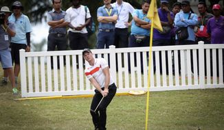 Danny Willett of England follows his shot on the 18th hole during the Maybank Championship golf tournament in Kuala Lumpur, Malaysia  Saturday, Feb. 11, 2017. (AP Photo/Vincent Thian)