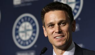 ADVANCE FOR USE SATURDAY, FEB. 11 - In this Sept. 29, 2015, file photo, Seattle Mariners general manager Jerry Dipoto speaks at a news conference in Seattle. Since arriving in Seattle as the Mariners general manager in September 2015, Dipoto has made more than 30 trades with the goal was to remodeling the franchise without increasing payroll through free agency. (AP Photo/Elaine Thompson, File)