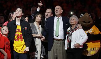 Former Maryland men's basketball coach Lefty Driesell, third from right, watches alongside his family as a banner honoring his career is unveiled in the rafters during a ceremony before an NCAA college basketball game between Maryland and Ohio State, Saturday, Feb. 11, 2017, in College Park, Md. (AP Photo/Patrick Semansky)