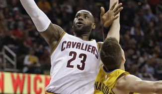 Cleveland Cavaliers' LeBron James (23) drives to the basket against Denver Nuggets' Juancho Hernangomez (41), from Spain, in the first half of an NBA basketball game, Saturday, Feb. 11, 2017, in Cleveland. (AP Photo/Tony Dejak)