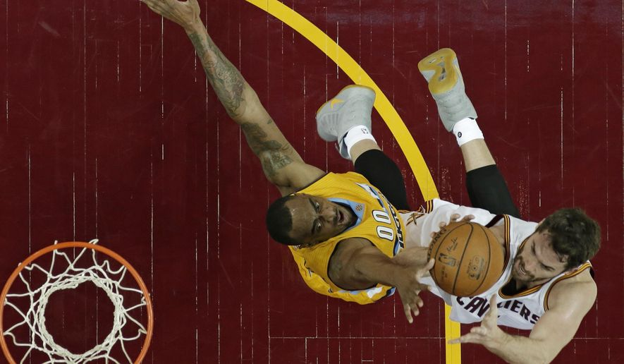 Cleveland Cavaliers' Kevin Love, right, drives to the basket against Denver Nuggets' Darrell Arthur in the first half of an NBA basketball game, Saturday, Feb. 11, 2017, in Cleveland. (AP Photo/Tony Dejak)
