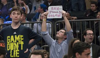 "A New York Knicks fan holds a ""Ban James Dolan"" sign during the second half of an NBA basketball game between the Knicks and the Denver Nuggets, Friday, Feb. 10, 2017, at Madison Square Garden in New York.The Nuggets won 131-123. (AP Photo/Mary Altaffer)"