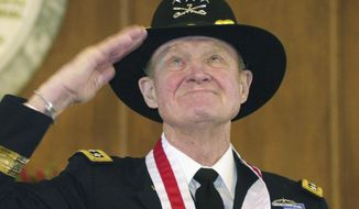 """FILE - In this Thursday, Jan. 29, 2004 file photo, retired Lt. Gen. Hal Moore, of Auburn, Ala., salutes the crowd during a standing ovation at the state capitol during the Spirit of Alabama Awards in Montgomery, Ala. Moore, co-author of """"We Were Soldiers,"""" was one of several recipients of the award, created by Gov. Bob Riley. On Friday, Feb. 10, 2016, Moore, known for saving most of his men in the first major battle between the U.S. and North Vietnamese armies, died. He was 94. (AP Photo/Jamie Martin)"""