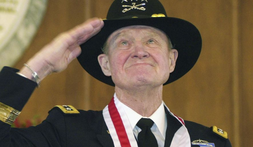 "FILE - In this Thursday, Jan. 29, 2004 file photo, retired Lt. Gen. Hal Moore, of Auburn, Ala., salutes the crowd during a standing ovation at the state capitol during the Spirit of Alabama Awards in Montgomery, Ala. Moore, co-author of ""We Were Soldiers,"" was one of several recipients of the award, created by Gov. Bob Riley. On Friday, Feb. 10, 2016, Moore, known for saving most of his men in the first major battle between the U.S. and North Vietnamese armies, died. He was 94. (AP Photo/Jamie Martin)"