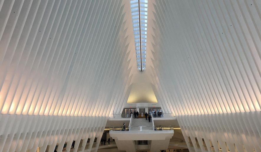 This Jan. 24, 2017 photo shows the interior of the Oculus in New York. Police say a 29-year-old woman plunged about 30 feet to her death off an escalator inside the famed World Trade Center Oculus.  They say she was apparently trying to retrieve a hat while on the escalator with her twin sister at about 5:30 a.m. Saturday inside the lofty transit hub. She fell to the main concourse floor.  Port Authority police spokesman Joseph Pentangelo said the woman was taken to a hospital where she was pronounced dead. Police are investigating the incident. Her name hasn't been released.  (AP Photo/Donald King)