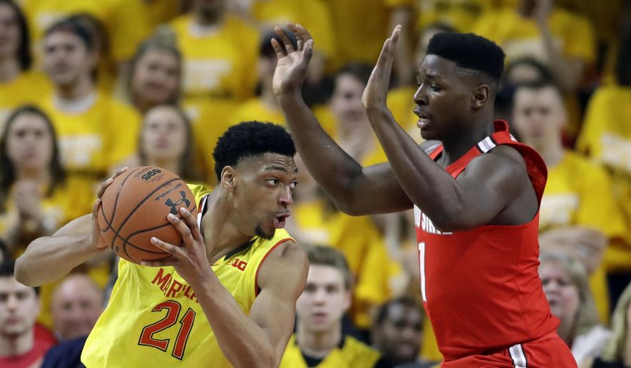 Maryland forward Justin Jackson, left, of Canada, drives around Ohio State forward Jae'Sean Tate in the first half of an NCAA college basketball game, Saturday, Feb. 11, 2017, in College Park, Md. (AP Photo/Patrick Semansky) ** FILE **