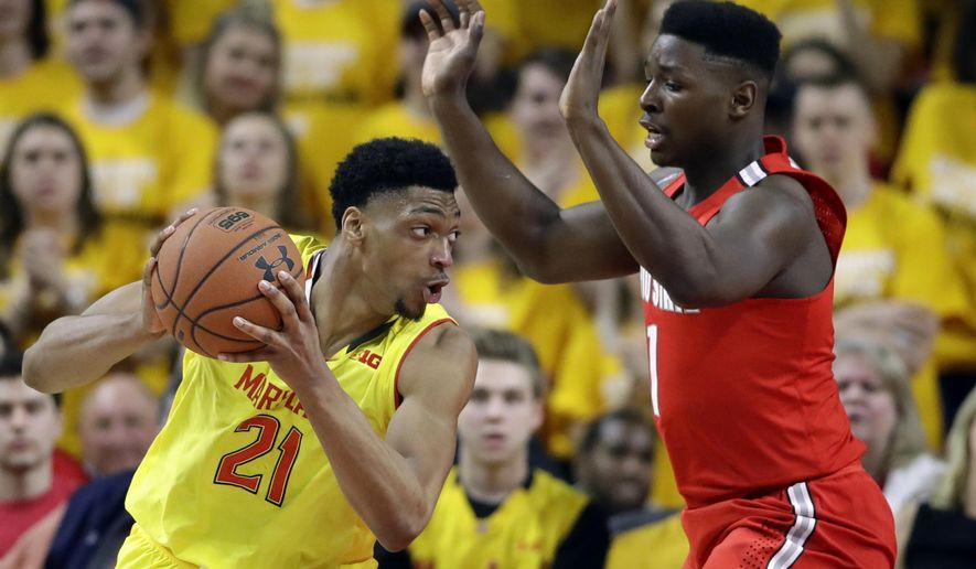 Maryland forward Justin Jackson, left, of Canada, drives around Ohio State forward Jae'Sean Tate in the first half of an NCAA college basketball game, Saturday, Feb. 11, 2017, in College Park, Md. (AP Photo/Patrick Semansky)