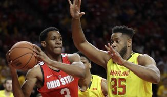 Ohio State guard C.J. Jackson, left, looks for a teammate as he is pressured by Maryland forward Damonte Dodd in the first half of an NCAA college basketball game, Saturday, Feb. 11, 2017, in College Park, Md. (AP Photo/Patrick Semansky)