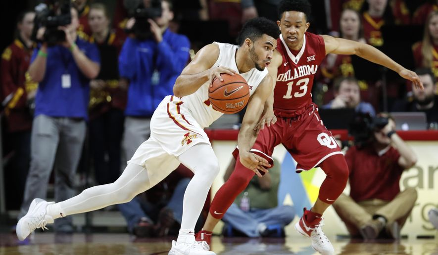 Iowa State guard Naz Mitrou-Long drives past Oklahoma guard Jordan Shepherd, right, during the first half of an NCAA college basketball game, Saturday, Feb. 11, 2017, in Ames, Iowa. (AP Photo/Charlie Neibergall)