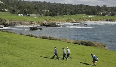 From left to right, Jake Owen, Jordan Spieth and Dustin Johnson walk up the eighth fairway of the Pebble Beach Golf Links during the third round of the AT&T Pebble Beach National Pro-Am golf tournament Saturday, Feb. 11, 2017, in Pebble Beach, Calif. (AP Photo/Eric Risberg)