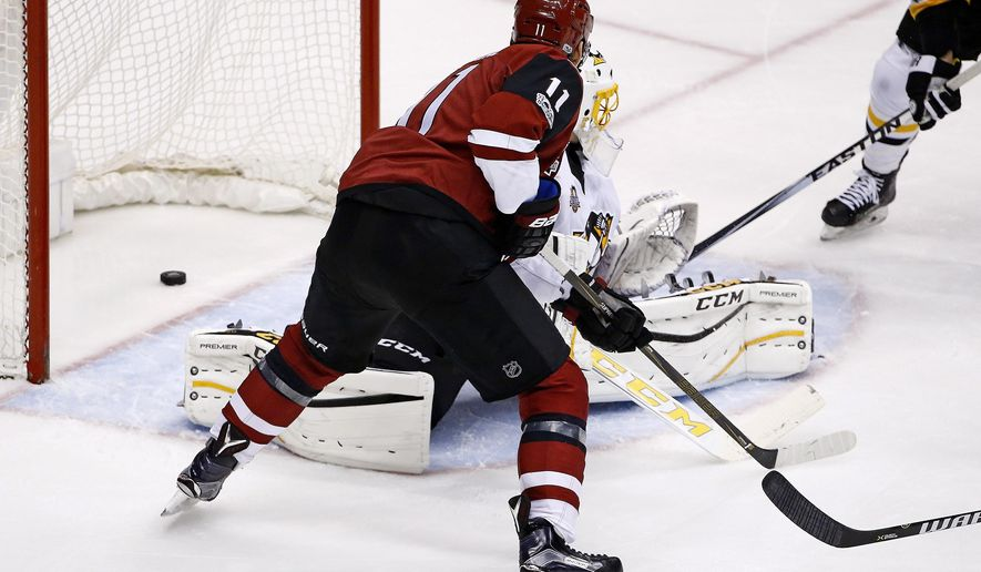 Arizona Coyotes center Martin Hanzal (11) scores a goal against Pittsburgh Penguins goalie Marc-Andre Fleury, right, during the second period of an NHL hockey game Saturday, Feb. 11, 2017, in Glendale, Ariz. (AP Photo/Ross D. Franklin)