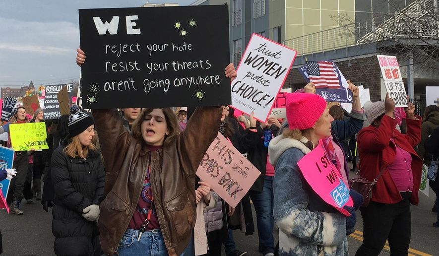 People march in support of Planned Parenthood in Detroit on Saturday, Feb. 11, 2017. . The event drew more than 300 people. (AP Photo/Ed White)