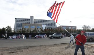 Jeff McNamara wears a Trump campaign hat as he waves a U.S. flag during an anti-abortion rally in front of Planned Parenthood of the Rocky Mountains, in Denver, Saturday, Feb. 11, 2017. (AP Photo/Brennan Linsley) ** FILE **