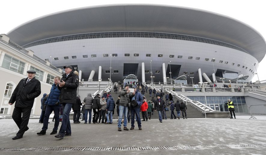 Spectators visit the new soccer stadium on Krestovsky Island in St. Petersburg, Russia, Saturday, Feb. 11, 2017. Ten thousand people came on Saturday to test the new St. Petersburg stadium built to host the matches of the Confederations Cup 2017 and the FIFA World Cup 2018. (AP Photo/Dmitri Lovetsky)