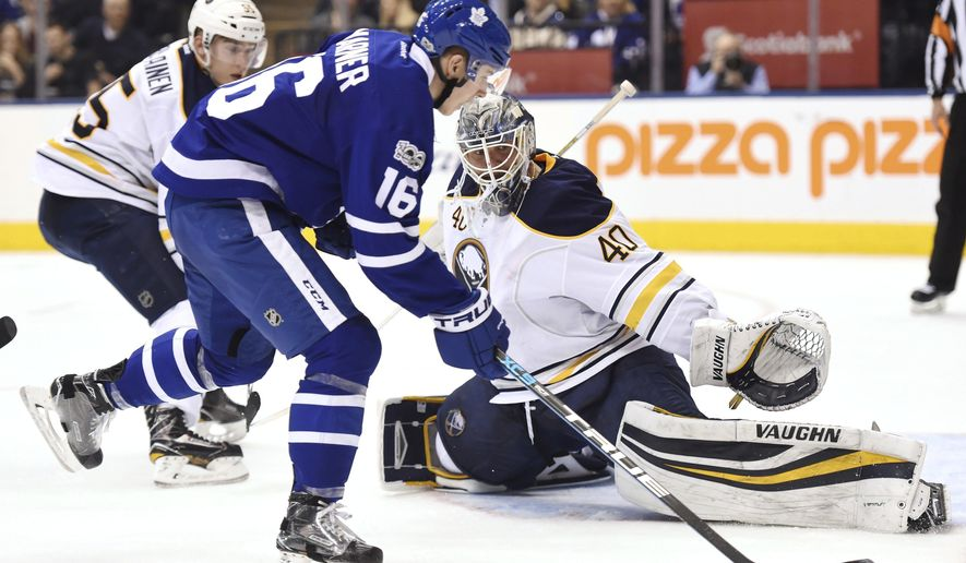 Buffalo Sabres goalie Robin Lehner (40) reaches to stop Toronto Maple Leafs centre Mitchell Marner (16) during second period NHL hockey action in Toronto on Saturday, Feb. 11, 2017. (Frank Gunn/The Canadian Press via AP)