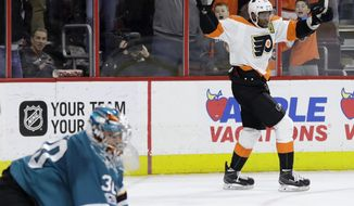 Philadelphia Flyers' Wayne Simmonds, right, celebrates after scoring the game-winning goal past San Jose Sharks' Aaron Dell during overtime of an NHL hockey game, Saturday, Feb. 11, 2017, in Philadelphia. Philadelphia won 2-1. (AP Photo/Matt Slocum)