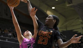 Oregon State guard Sydney Wiese (24) is blocked by Southern California forward Asiah Jones (23) during the first half of an NCAA college basketball game Friday, Feb. 10, 2017, in Corvallis, Ore. (Anibal Ortiz/Corvallis Gazette-Times via AP)