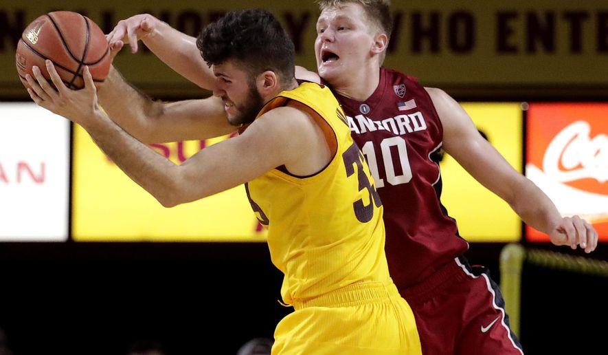 Stanford forward Michael Humphrey (10) and Arizona State forward Ramon Vila battle for the rebound during the second half of an NCAA college basketball game, Saturday, Feb. 11, 2017, in Tempe, Ariz. (AP Photo/Matt York)
